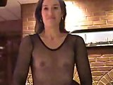 Sexy Suz masturbating with her fishnet suit on