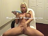 Huge boobs girl playing with two dildos