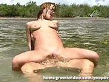 Horny Couple Fucks Outside In The Water