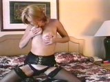 Blonde plays with her hairy black haired pussy