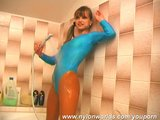 Pigtail girl showering in nylon dress