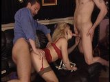 Hot blonde in sexy red lingerie takes on two cocks.