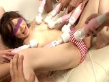 Blindfolded Asian swarmed by vibrators