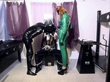Latex freaks dominate a slave