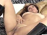 Milf toys her swollen clit