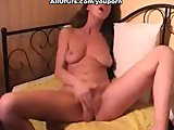 Nasty naked brunette masturbates