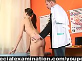 Brunette girl examined by gynecologist