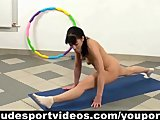 Flexible girl doing nude gymnastics