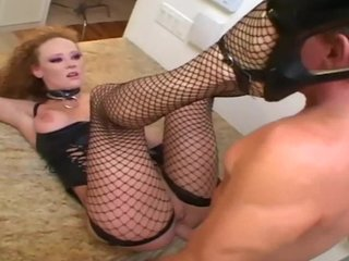 Lingerie Slave Fishnet video: Redhead has sex in leather and fishnet stockings