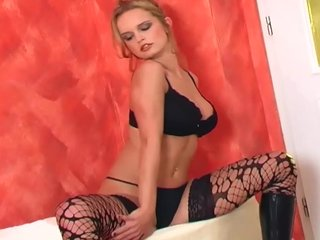 Lingerie Boots Glamour video: Glamour babe in boots and stockings rubs her pussy