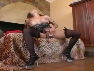 Lingerie Stripping Heels video: Busty milf in stockings a bra and sexy high heels