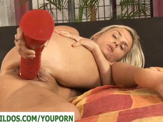Tight pussy with a huge red dildo