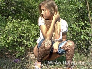 Hairy Blondes video: Hairy woman Riana S enjoys her walk outside