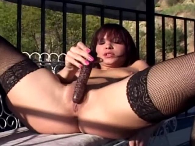 Stockings Brunette video: Masturbation outdoors in black fishnet stockings
