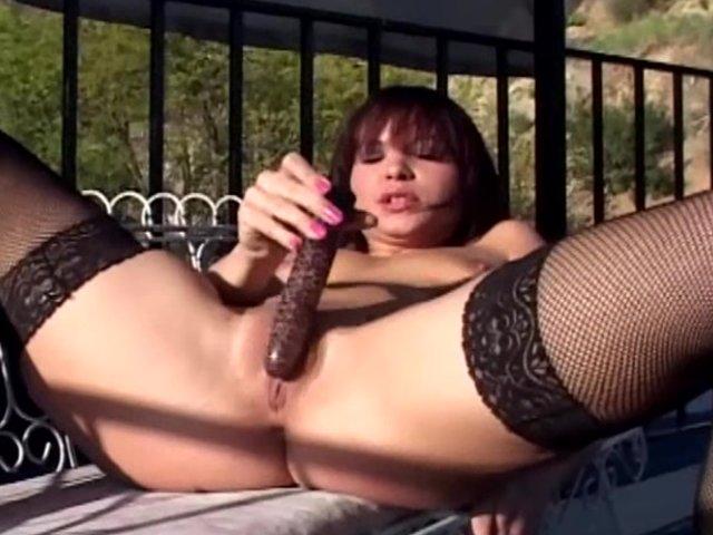 Stockings Brunette video: Masturbation outdoors in black fishnet stockings