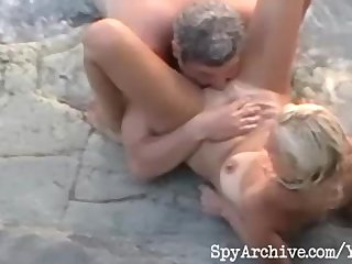 Hidden Camera Spy Camera Sex On The Beach vid: Voyeur video of a horny mature couple having sex